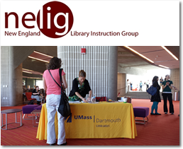 NELIG Logo and Picture of Registration Desk @ UMassD