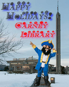 Image of Arnie the Corsair with a snowy Claire T. Carney Library behind in the distance.