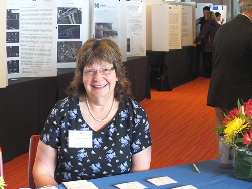 Liz Winiarz, Librarian, at The 21st Annual Sigma Xi UMass Dartmouth Research Expo Registration Table